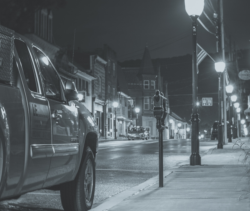 """The owner of this truck was surprised to see me squatting down with my tripod next to his truck. Can you imagine? You mosey out your front door to go to work and there is some silver haired woman wearing a flashing vest squatting next to your truck! """"Truck view of Main Street"""" (c) Rebecca LaChance, 2015, Thurmont, MD."""