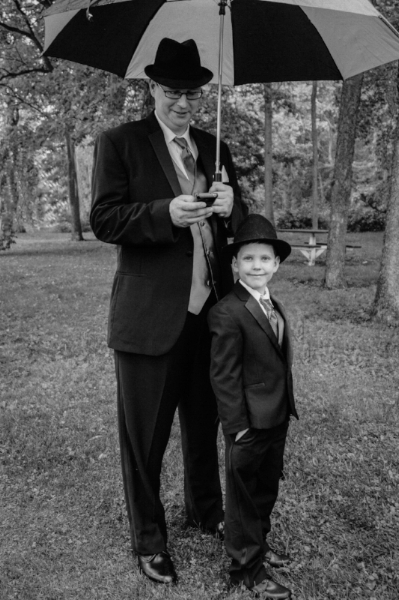 Two cool dudes waiting for a wedding. Travis (talldude) and Damien (small dude) waiting patiently in the pouring rain. The rain broke at a very tight 30 minutes for the ceremony to take place. (c) Rebecca LaChance, 2015, Yorktown, IN.