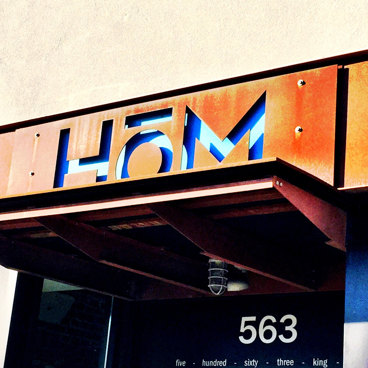 I love this sign.  That orange metal is called cor-ten steel.  It forms a natural rust finish that actually protects the metal.  HoM has great burgers, delicious cocktails and a couple ping-pong tables in the back.  What's not to like?
