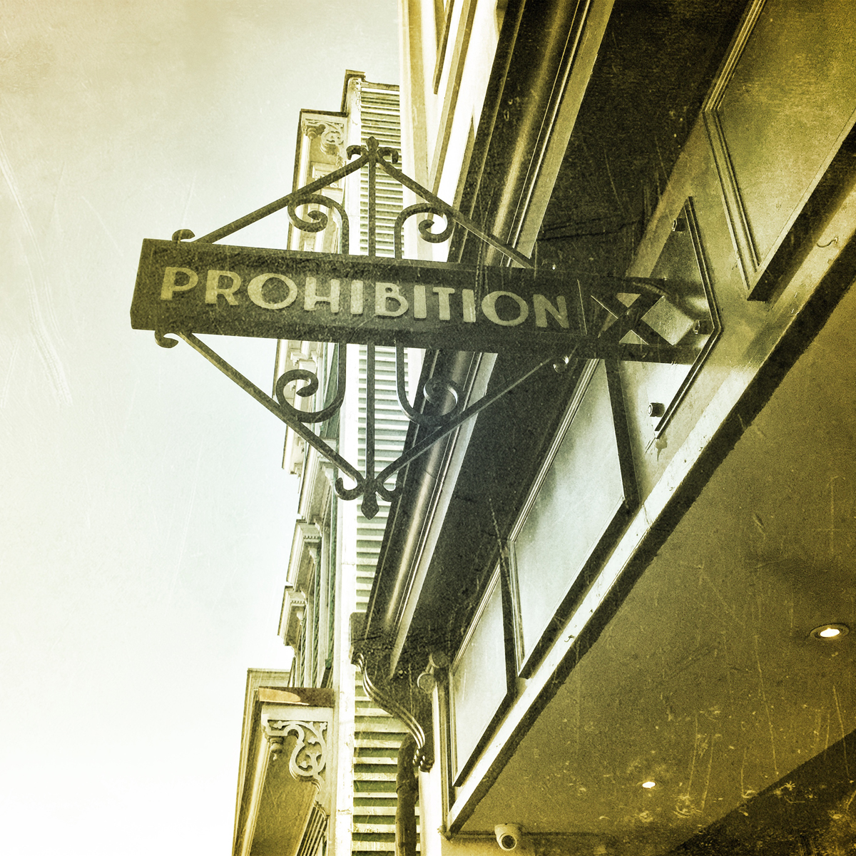 A few years ago I noticed a trend in the Charleston bar scene towards 20's era design and old fashion cocktail menus.  I heard someone actually refer to it as prohibition era design.  And then this place came along and actually called itself Prohibition.  Wondering how I created the look on this picture.  I used the Camera + grunge filter.
