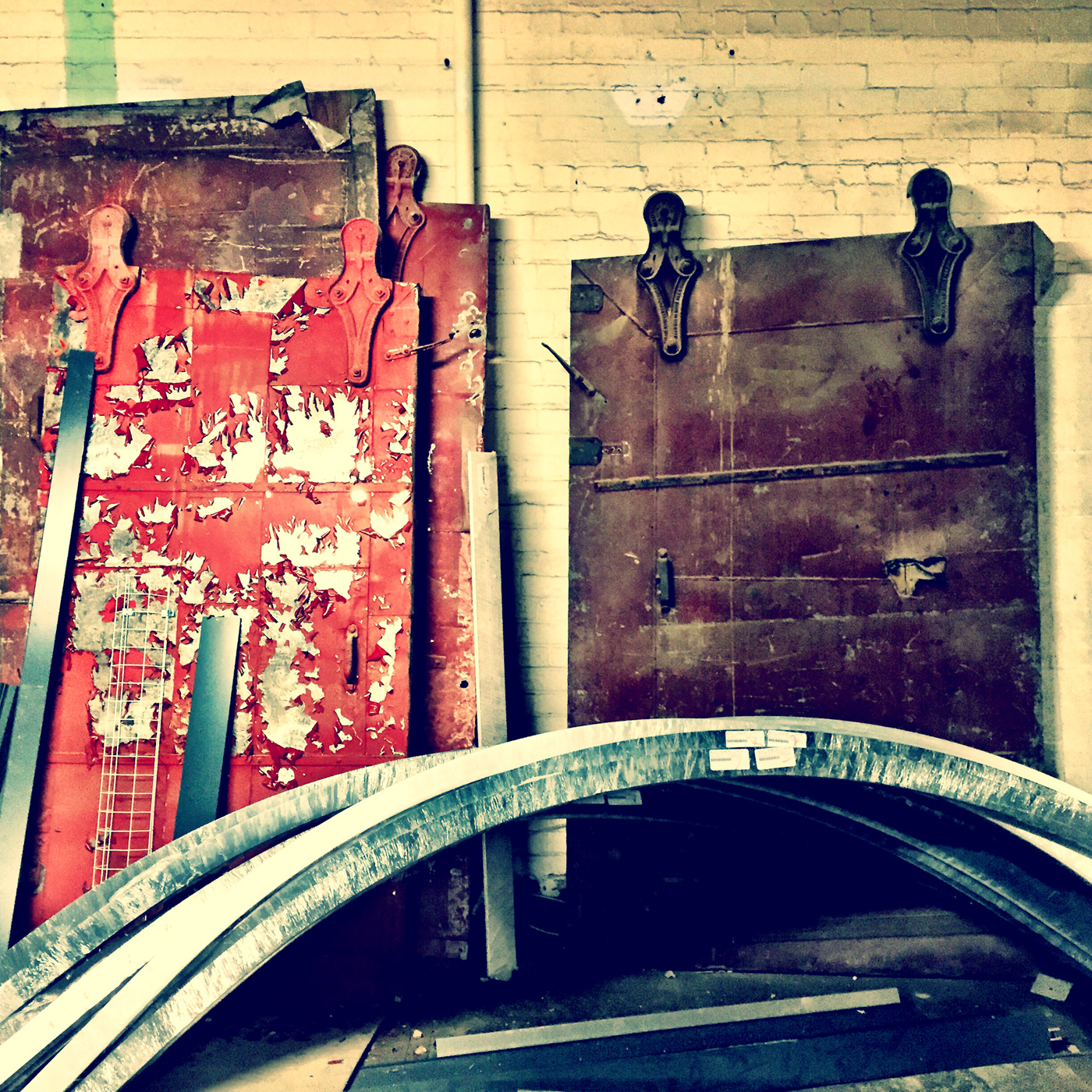They had these old doors stacked up against the wall. I wonder what they will do with them?