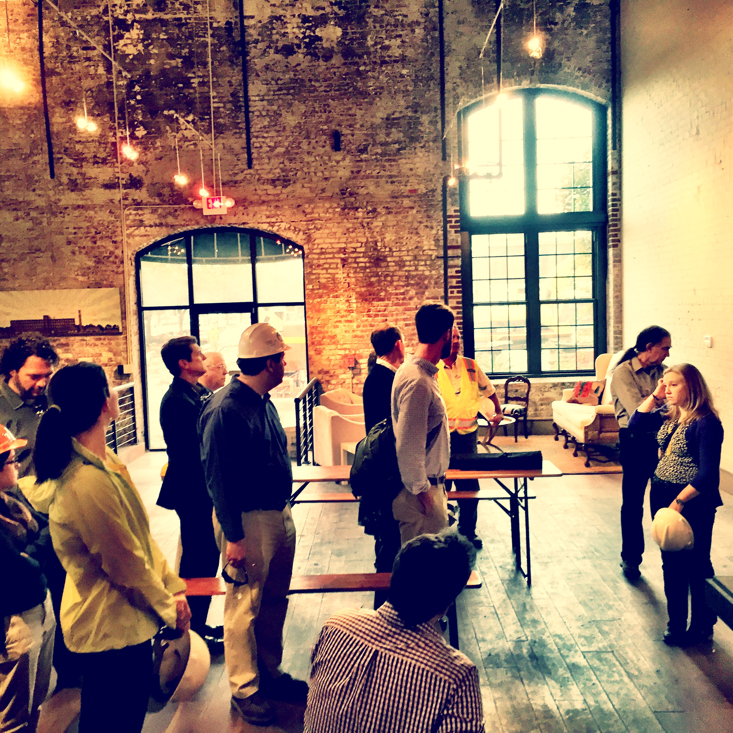 Eager architects waiting for their tour! This is the leasing office.