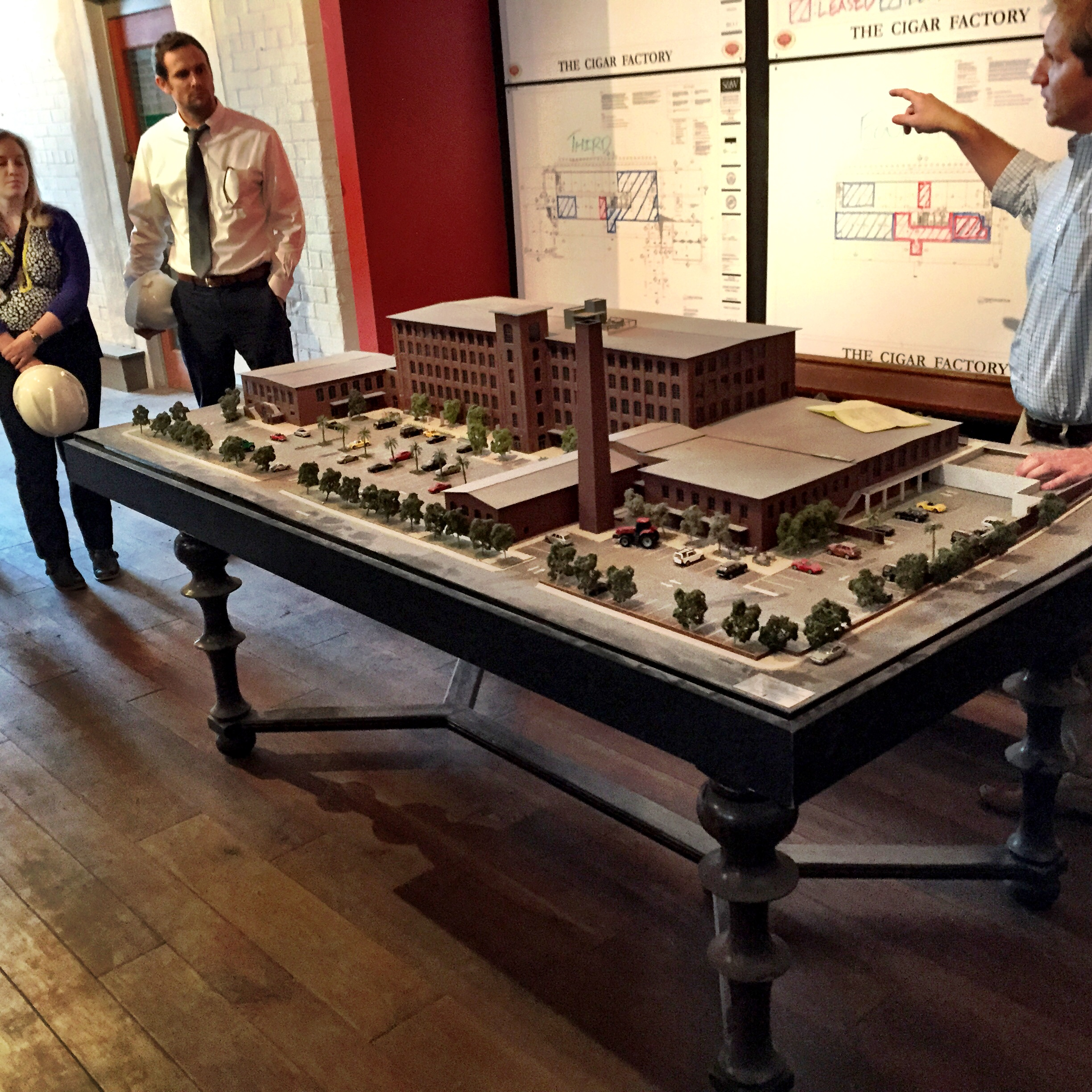 To the rightis Todd Bullwinkle withTrident Construction giving us the skinny on the project. That is the model of the Cigar Factory.