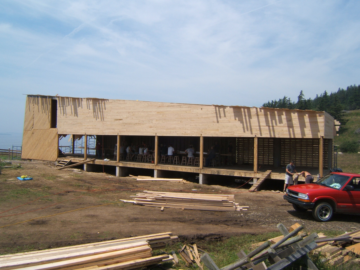 You can see how we ran the roof sheathing long and came back later to cut.