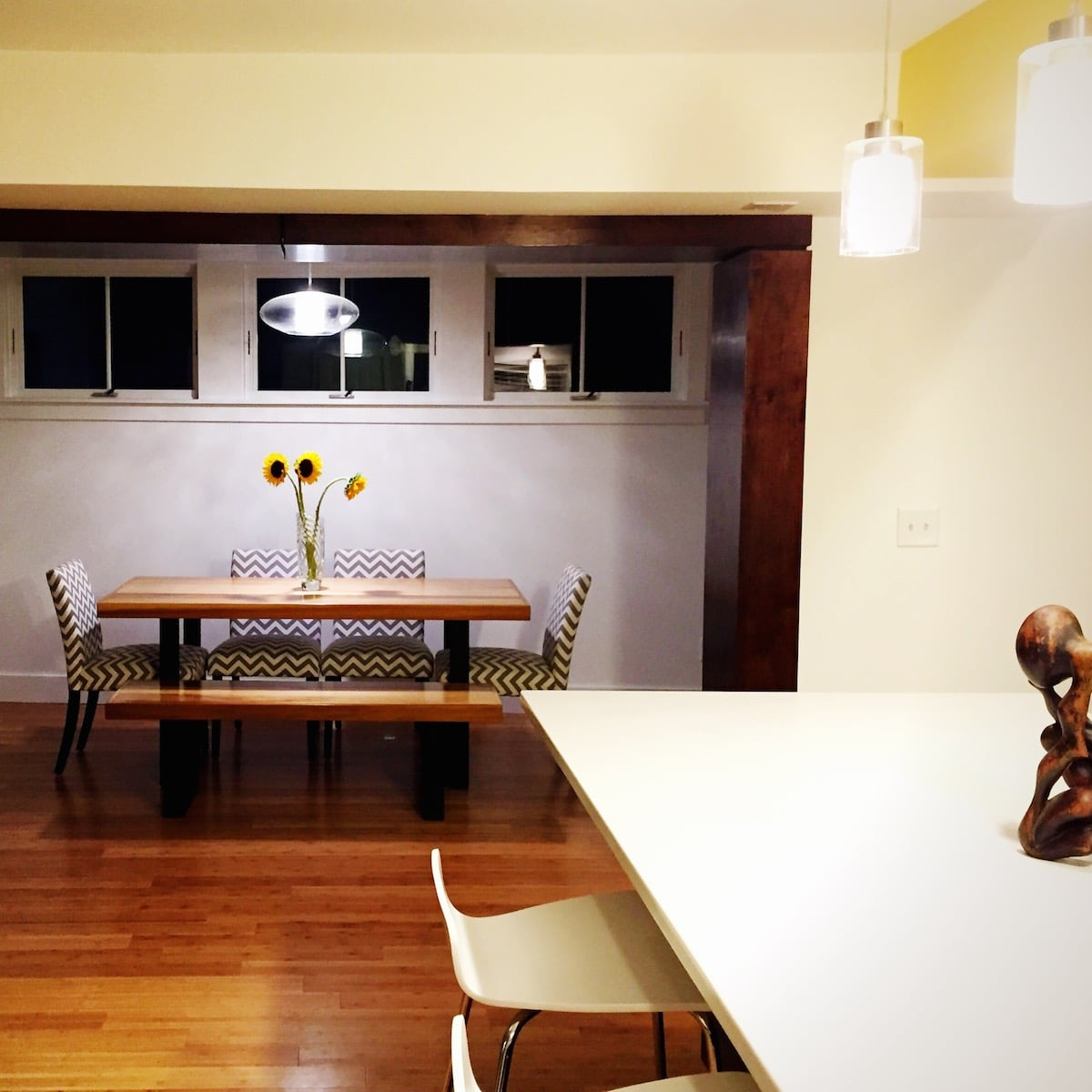 View from our recently renovated kitchen into our newly added dining room. Interesting fun fact. That little wooden sculpture in the foreground was purchased from a street vendor in Rome. True story.