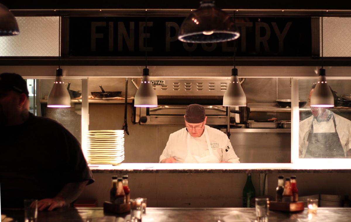 Remember when the kitchen was always hidden at restaurants? What were we thinking? Photo Credit: Miguel Buencamino