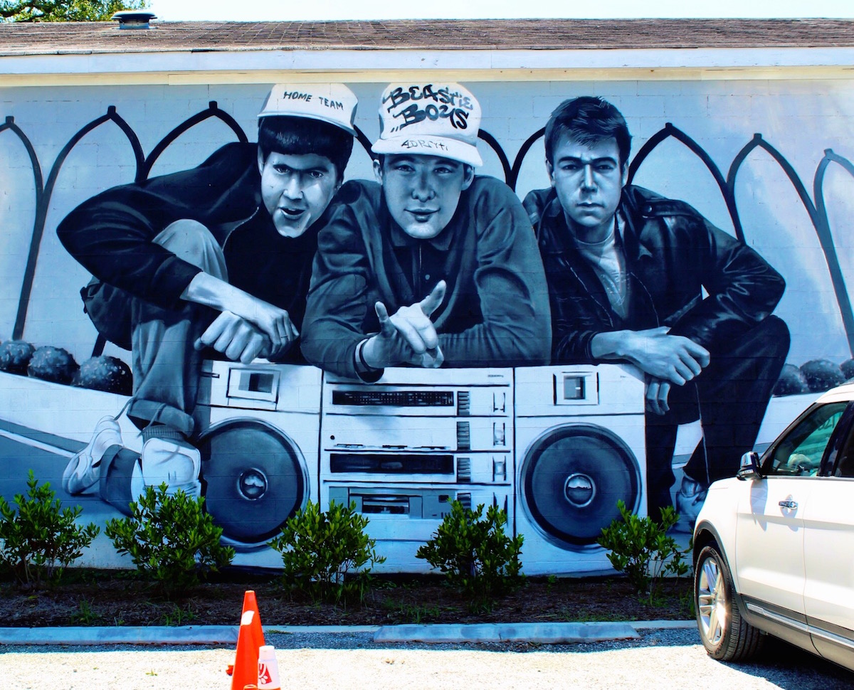 This Beastie Boys mural is painted on the side of one of the Home Team BBQ buildings. The artist is Sérgio Odeith.