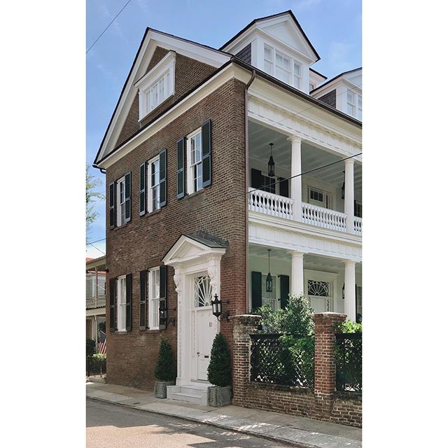 Good morning from Limehouse Street!  This #singlehouseoftheday has 2 unique features.  Or at least 2 that are front and center.  The first one is that the brick facade and gable roof stretches all the way across the piazza (side porch). Typically the piazza would show itself on the front facade as a separate mass from the body of the building.  The second unique feature is that amazing piazza door.  The fan detailing on the transom window is 💯. In fact all the detailing around the door is 😍. What do you think?  #dailydoseofcharleston
