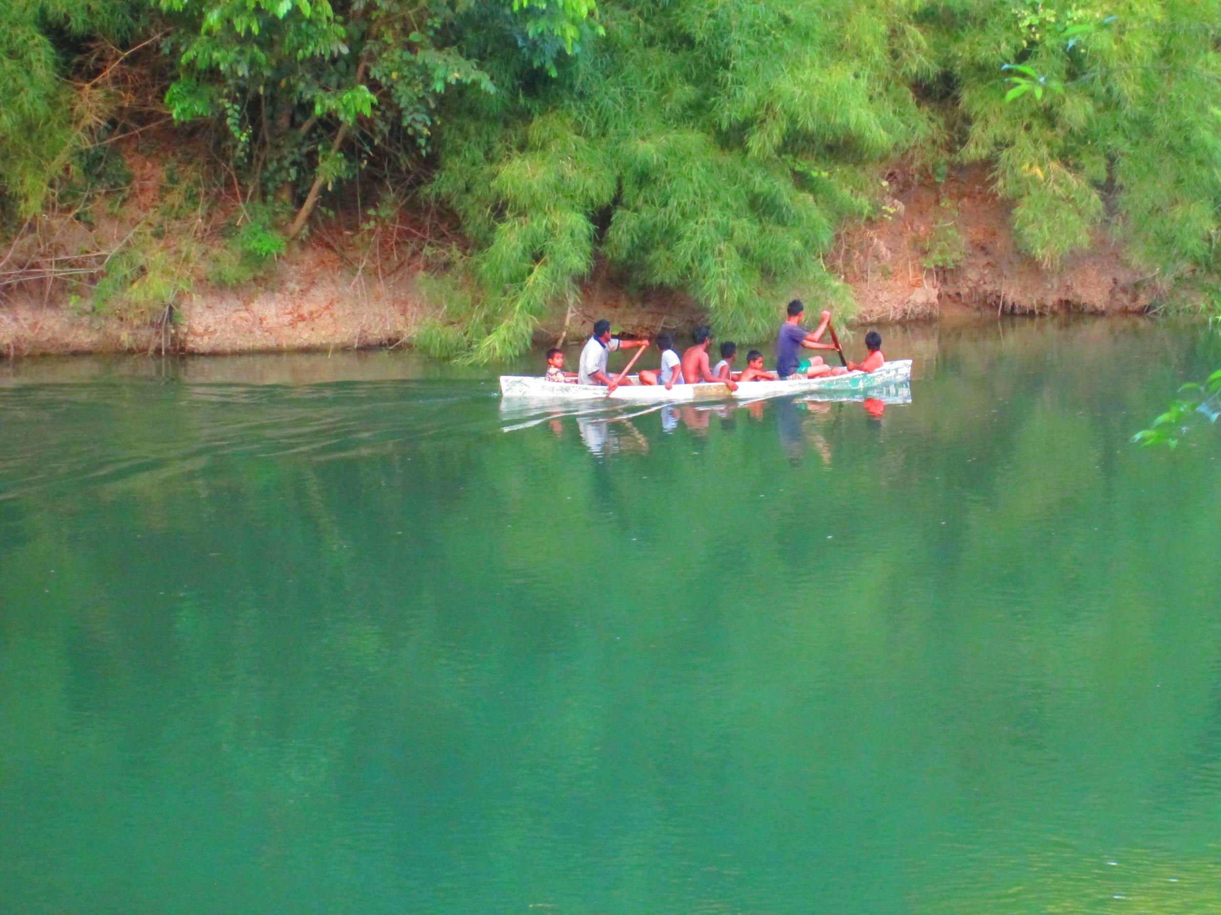 Local canoe on Belize River.JPG