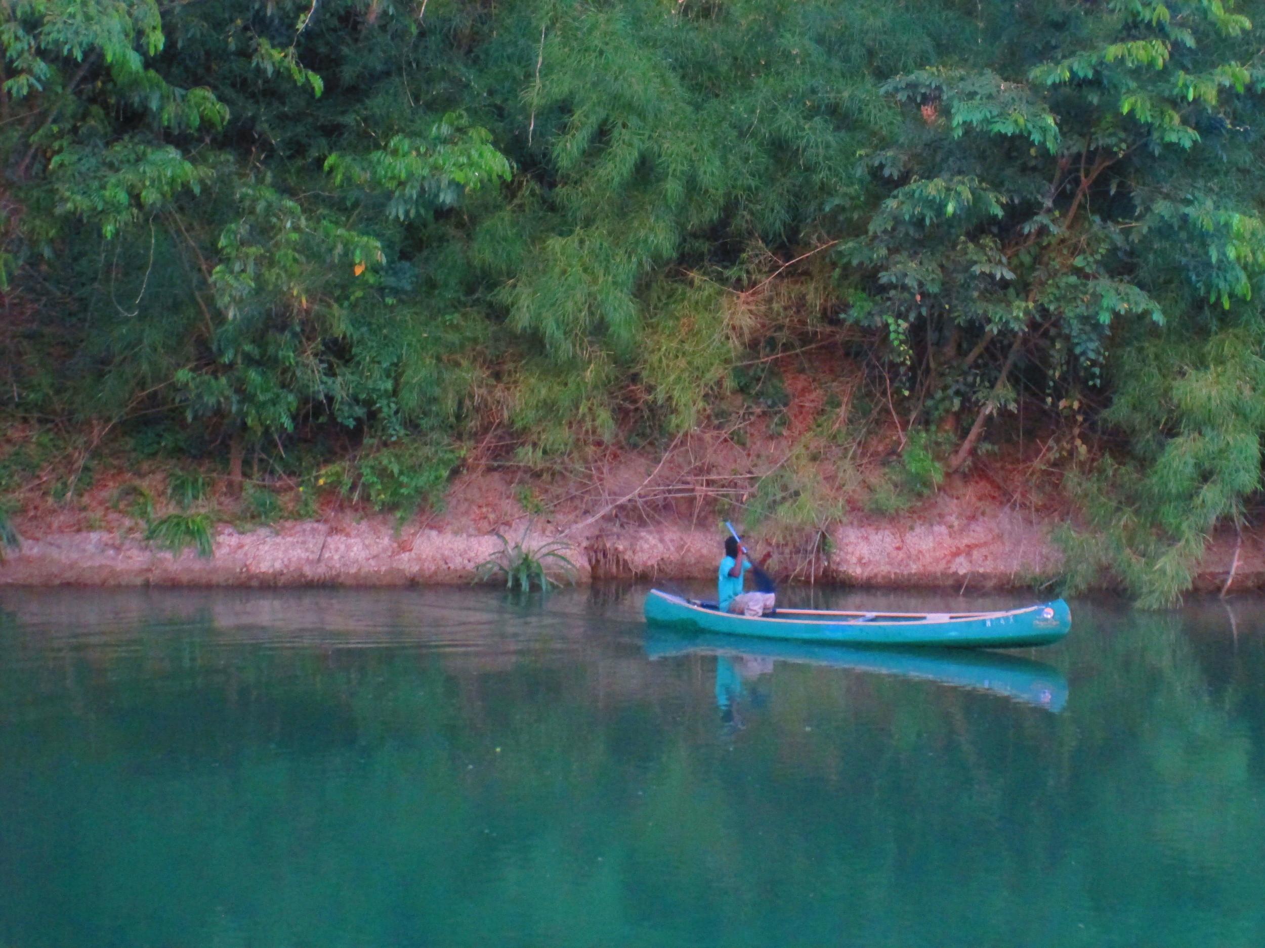 Turqois canoe on Belize River.JPG