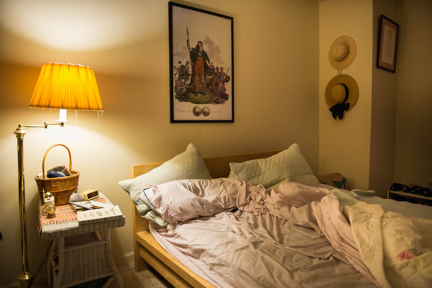 The bed sits unmade in the early morning hours in Joani Peacock's bedroom at her Alexandria, Va., home, Saturday, Oct. 4, 2014. Peacock says that she strives to live a balanced life with bipolar disorder and surrounds herself with objects she has collected, including an image of Celtic war queen Boudicea that hangs over her bed.