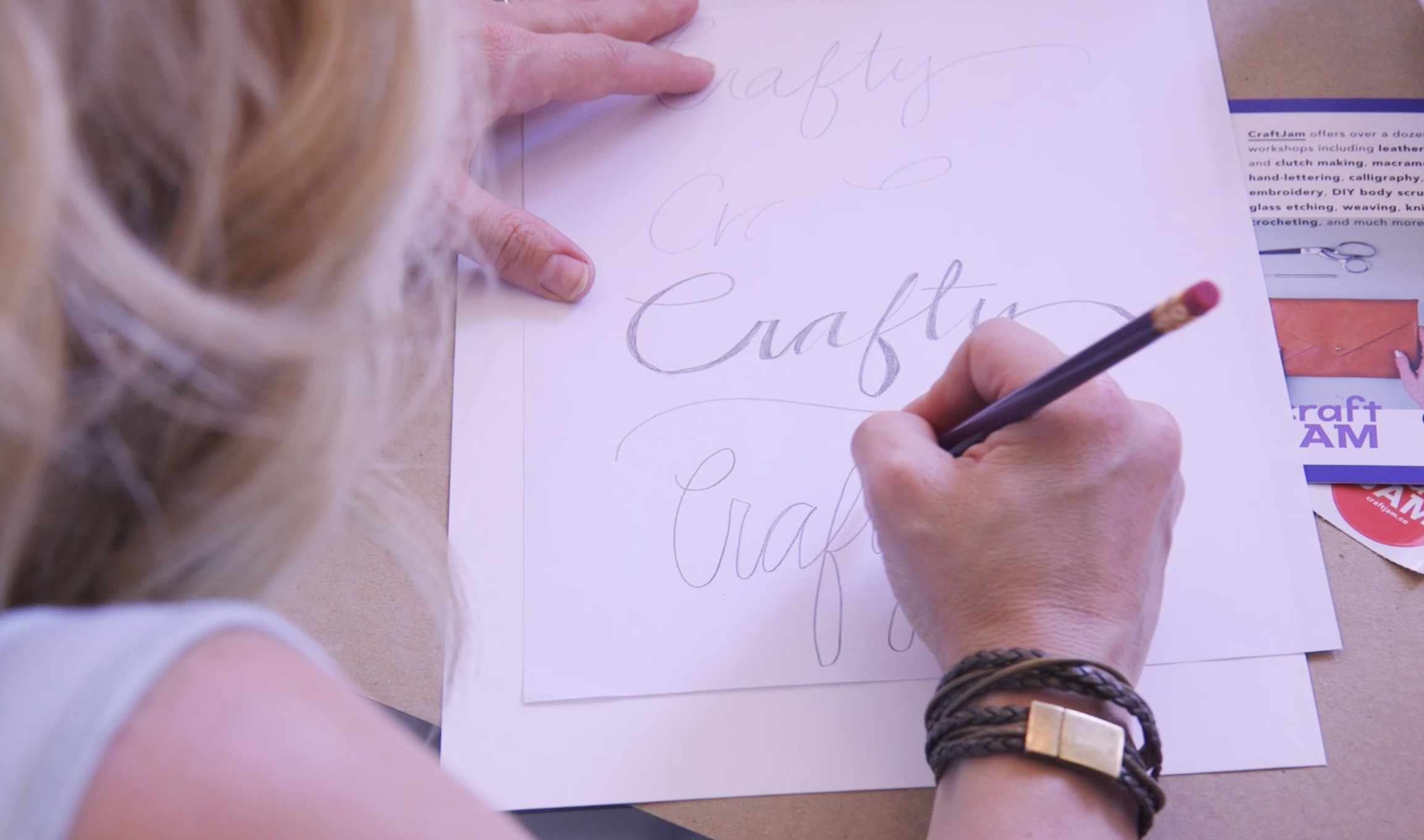 A Sharpie team participant practicing her calligraphy skills.
