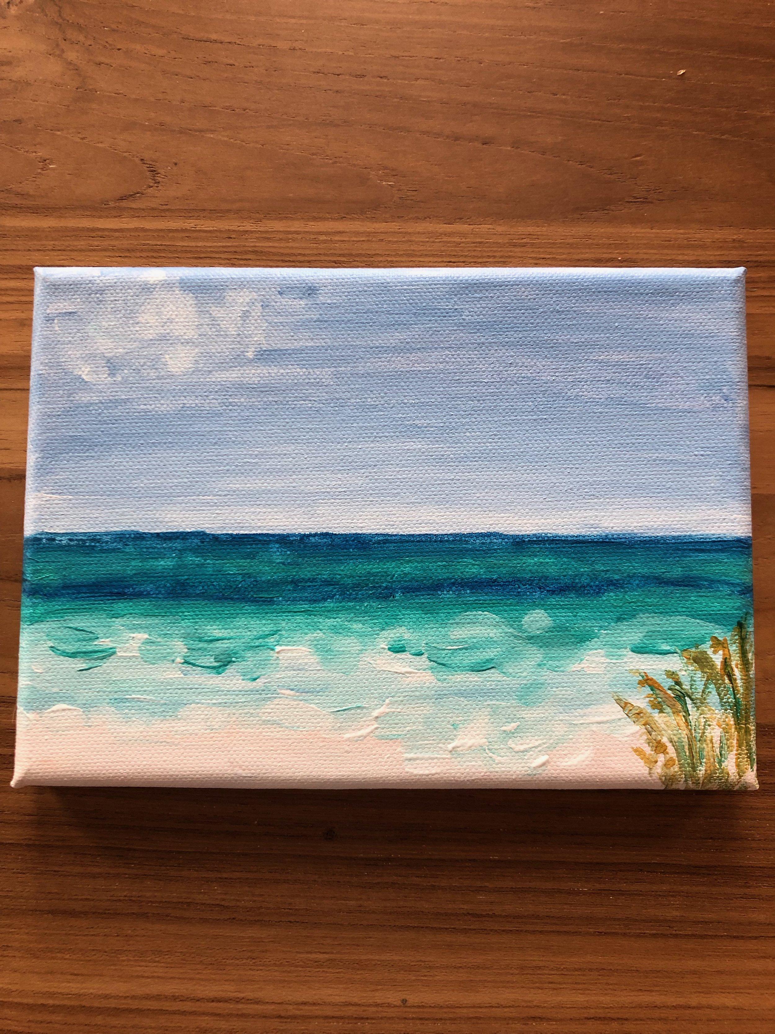 More emerald sea and white beach