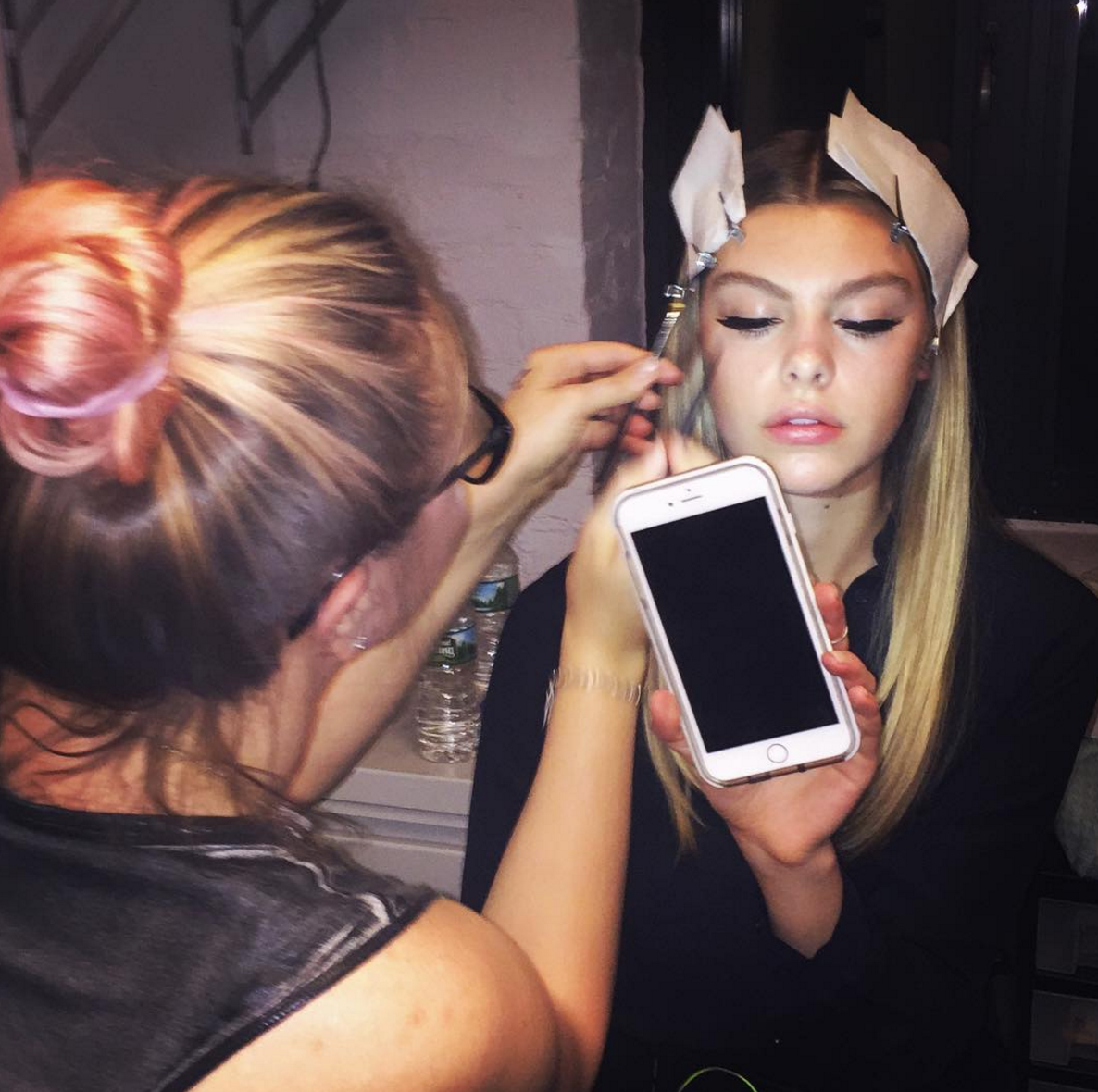 BTS of Lindsey working at NYLON.png