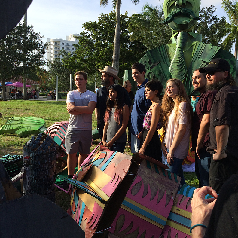 The end of a successful parade.  Wayne (second from left) with students and faculty from New World School of the Arts, Miami who volunteered to help create and build the creatures pose for media after a successful event..