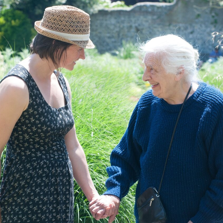 Care worker supporting client with dementia