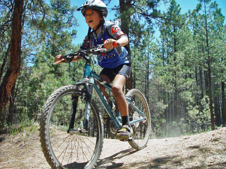 After raising a daughter - who mountain bikes, I often get the question, how did you get her to ride with you? The short answer is patience and practice. She didn't always go willingly. Sometimes I had to persuade her with ice cream. But when we finished the ride, she was always happy about her accomplishment.