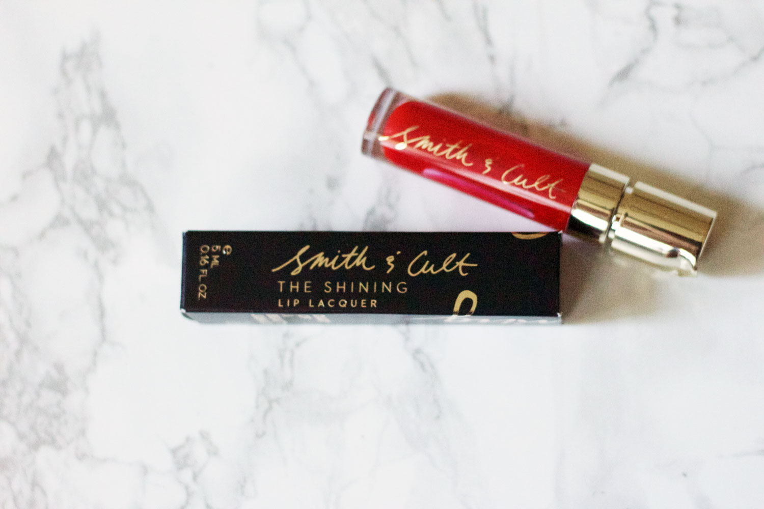 SMITH & CULT Lip Laquer in The Warning : I've been a fan of this brand for awhile now ever since I started using their nail polish, so when I saw a lip product from them to try, I of course was super excited. This will be a great go-to during the holidays!