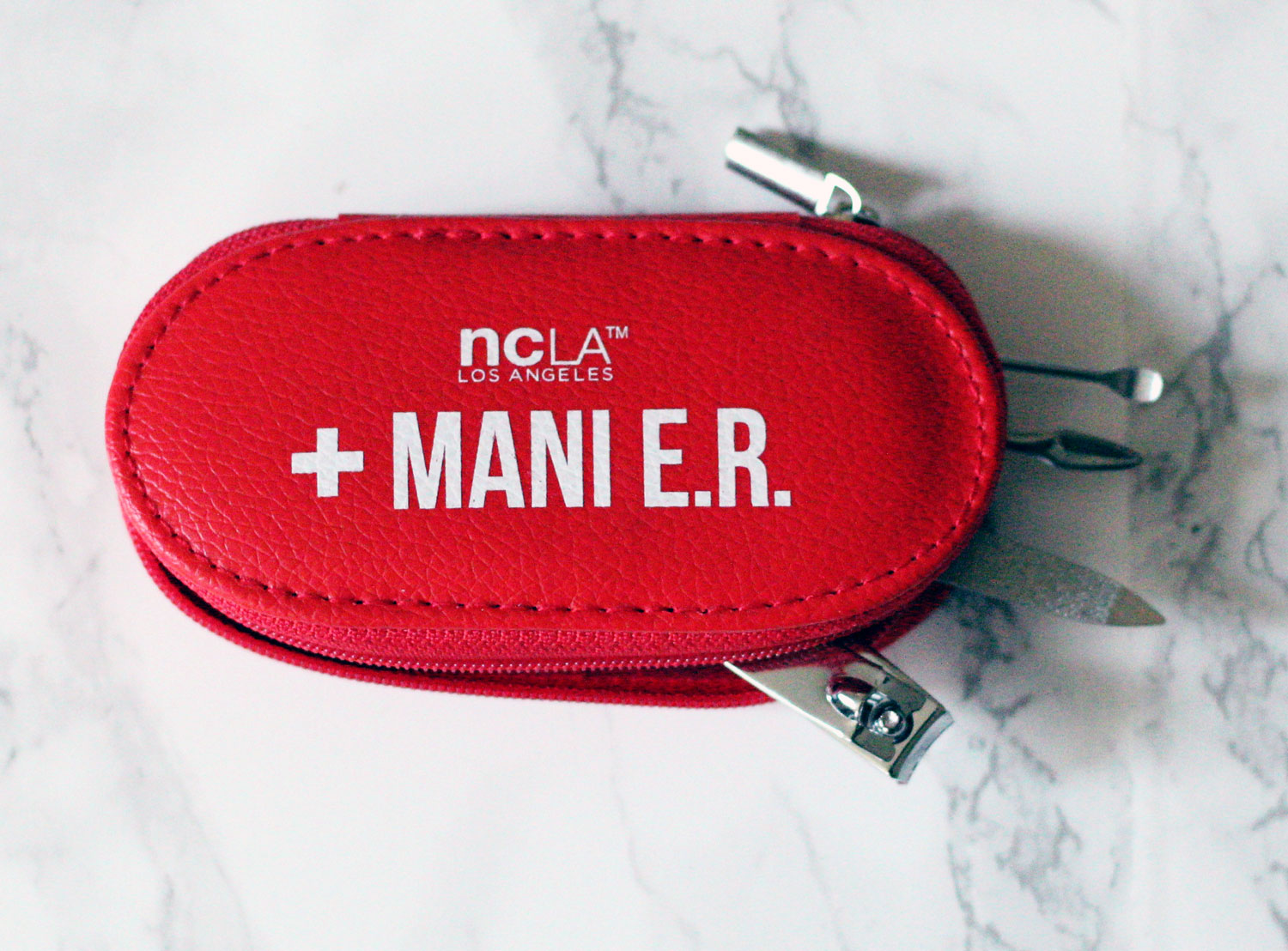 NCLA MANI-ER Tool Kit : Is POPSUGAR trying to tell me something? Ha! My nails have been needing this lately. Time to get back on my nail game, and what a great reminder to through in my bag to make sure that I do!