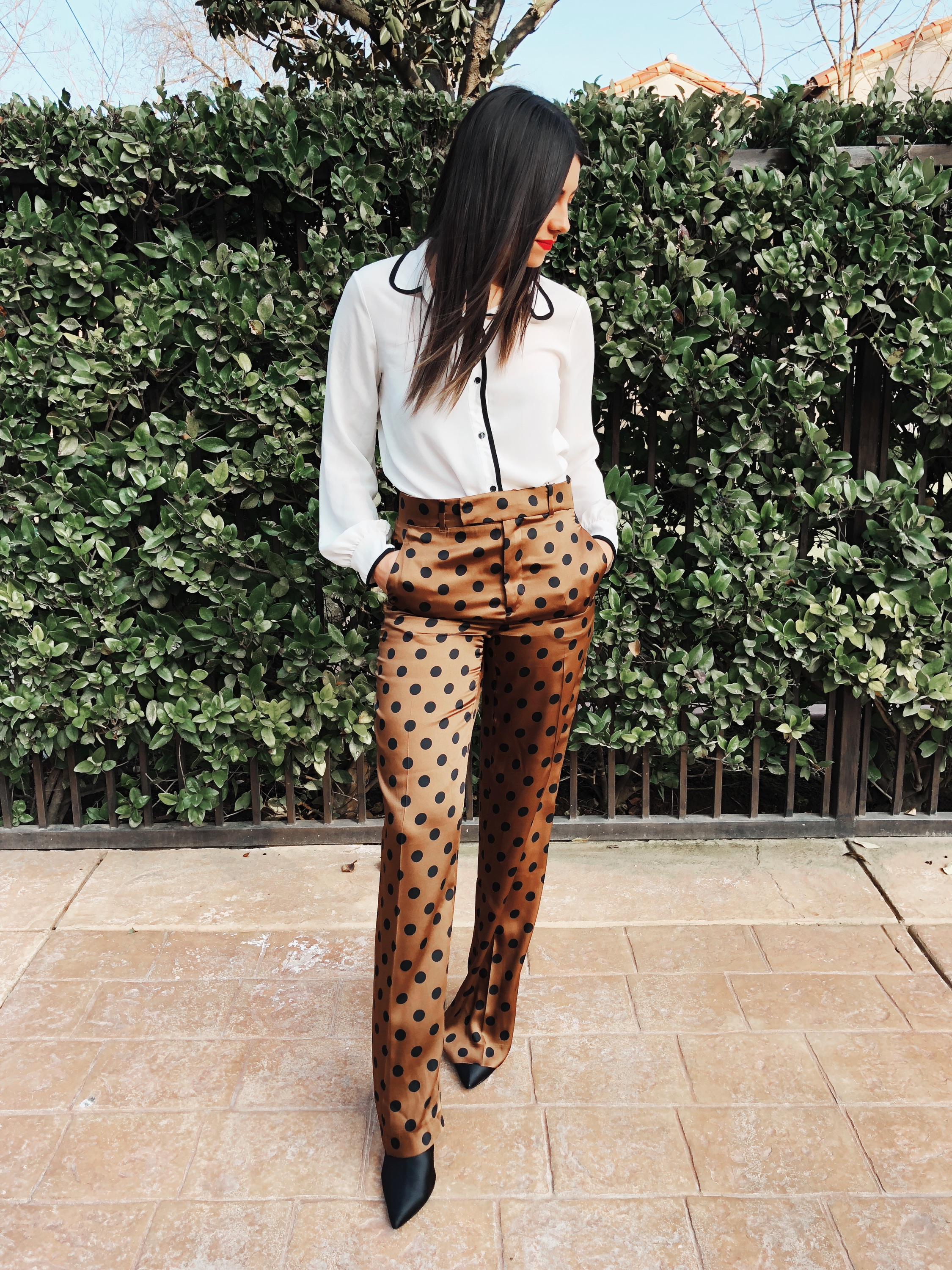 A MEETING - A classic which blouse can be paired with just about anything. Yes, even polka dot pants.