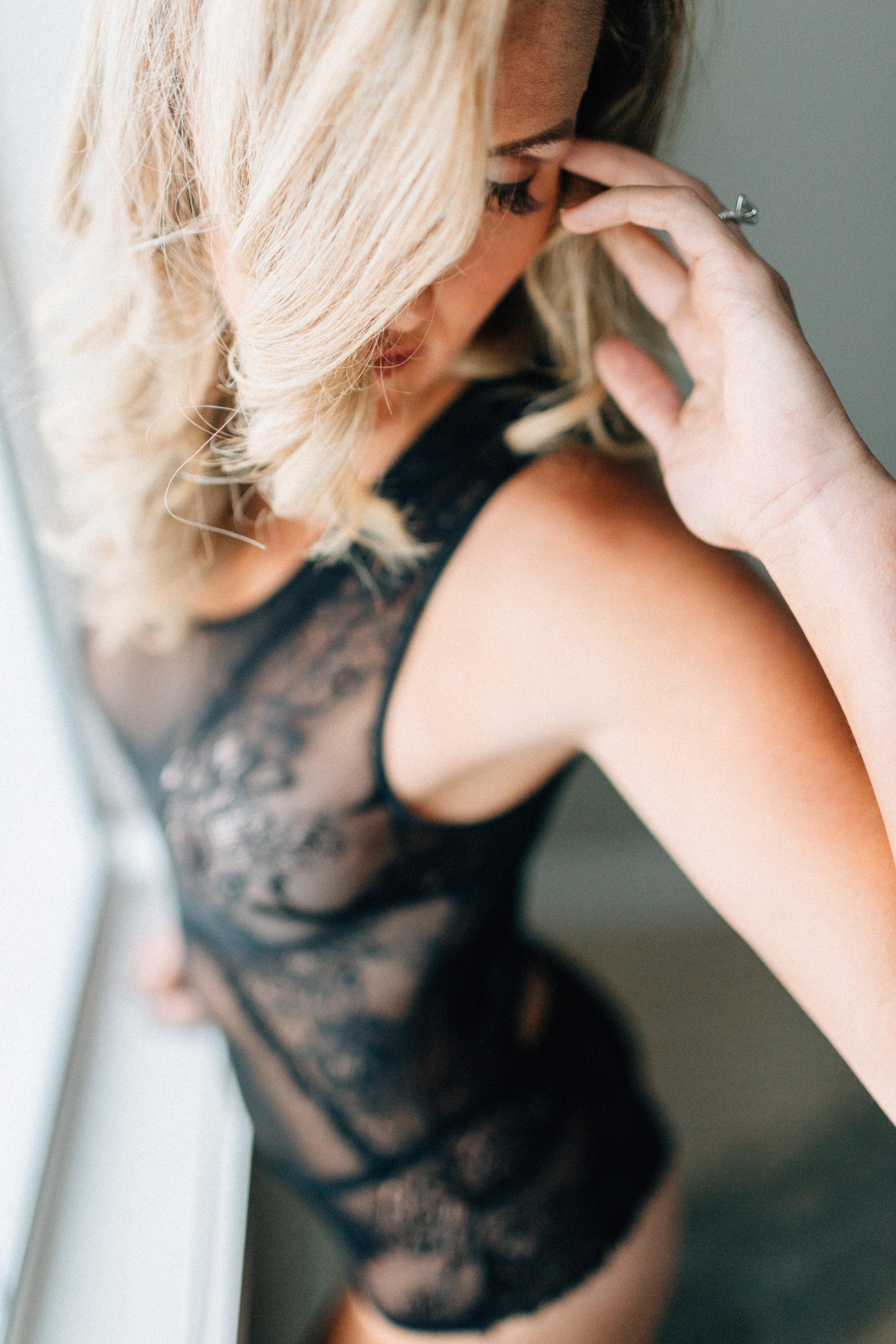 blonde model with black lace lingerie at San Diego boudoir studio