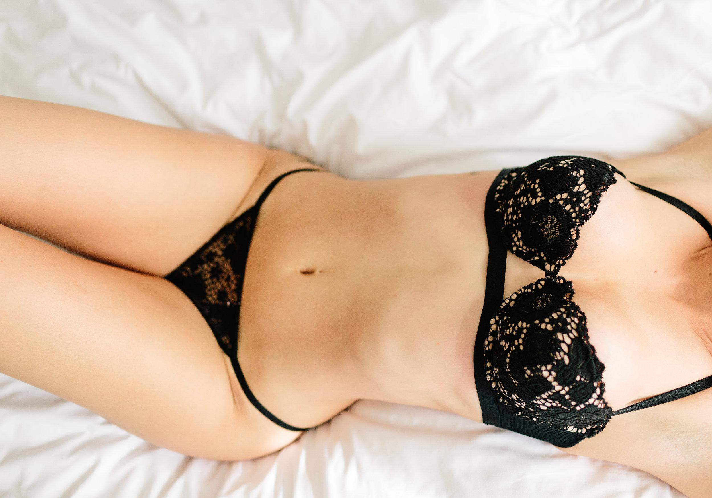 Victorias secret black lingerie on white sheets boudoir session