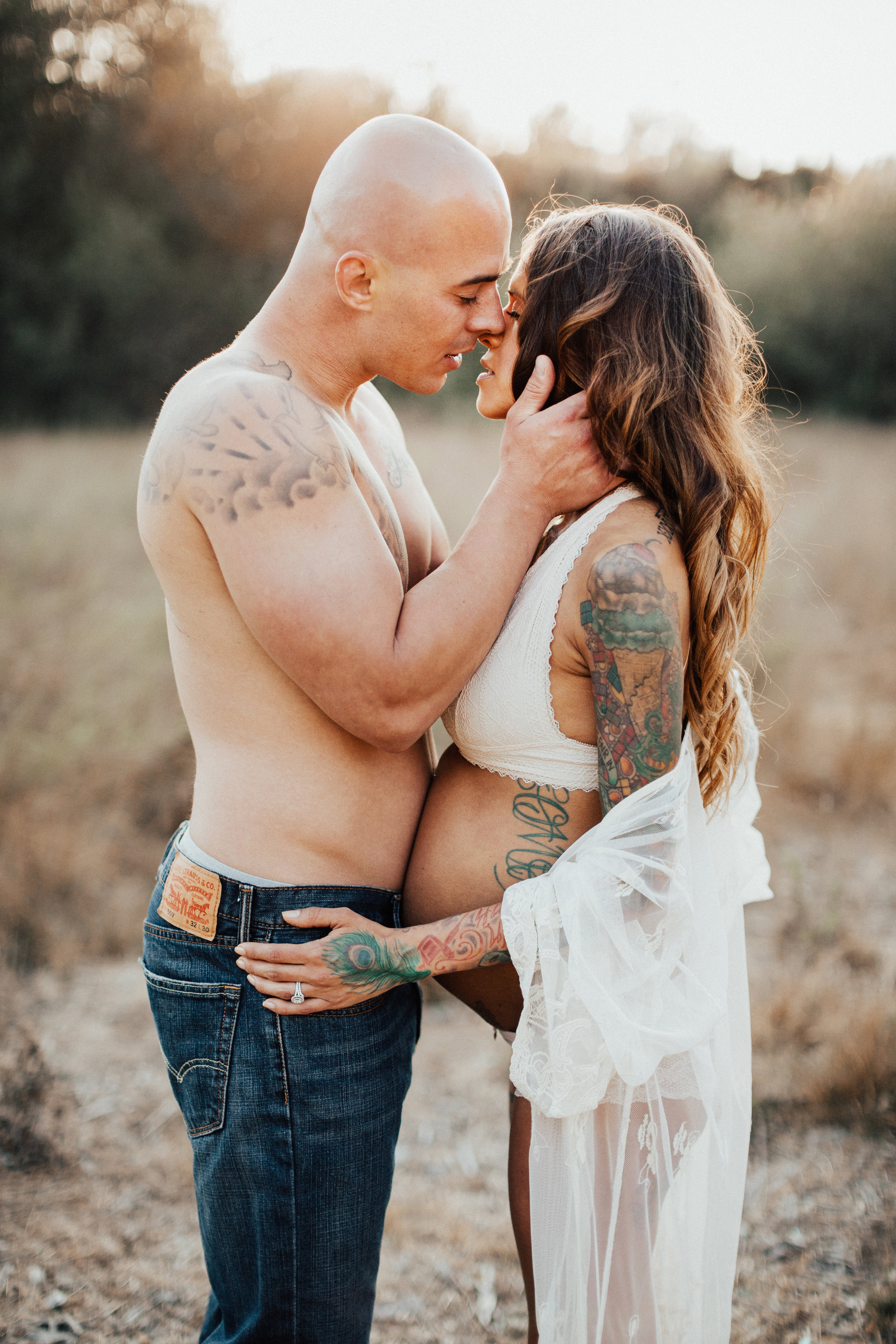 boho boudoir maternity session outdoors with mom and dad with tattoos San Diego