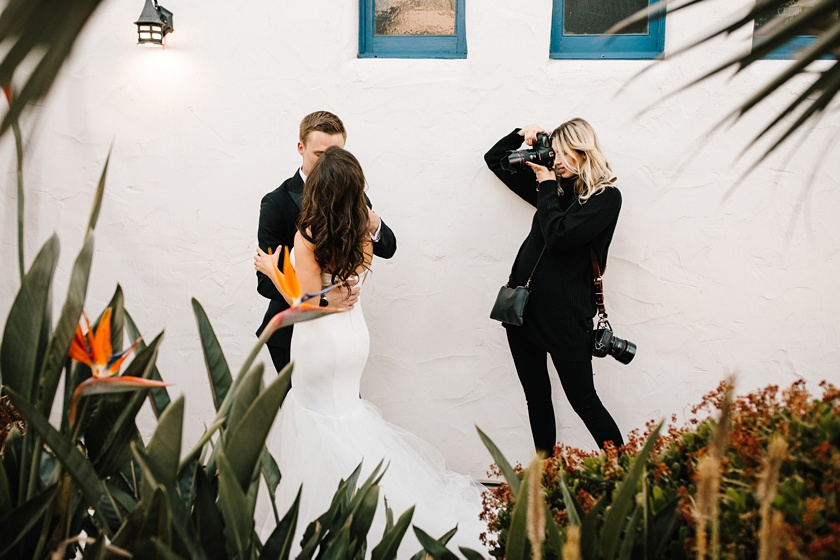 Orange County romantic wedding photographer couple at a wedding behind the scenes photographer