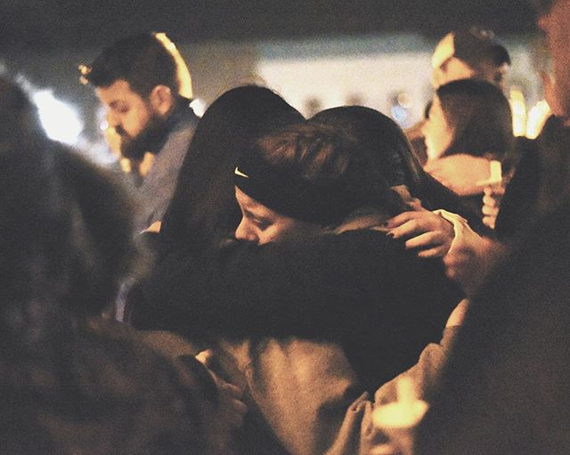 Monroe students hug each other during a candlelight vigil for three students who died in a car crash Friday afternoon.  Most of the time I get to photograph the happy moments in people's lives, but last night I had to photograph a grieving community. Unfortunately, this something that almost always affects us all at some point. Please, be safe while driving. I can't say it enough. Slow down and pay attention. #prayformonroe #greencountywi #vigil