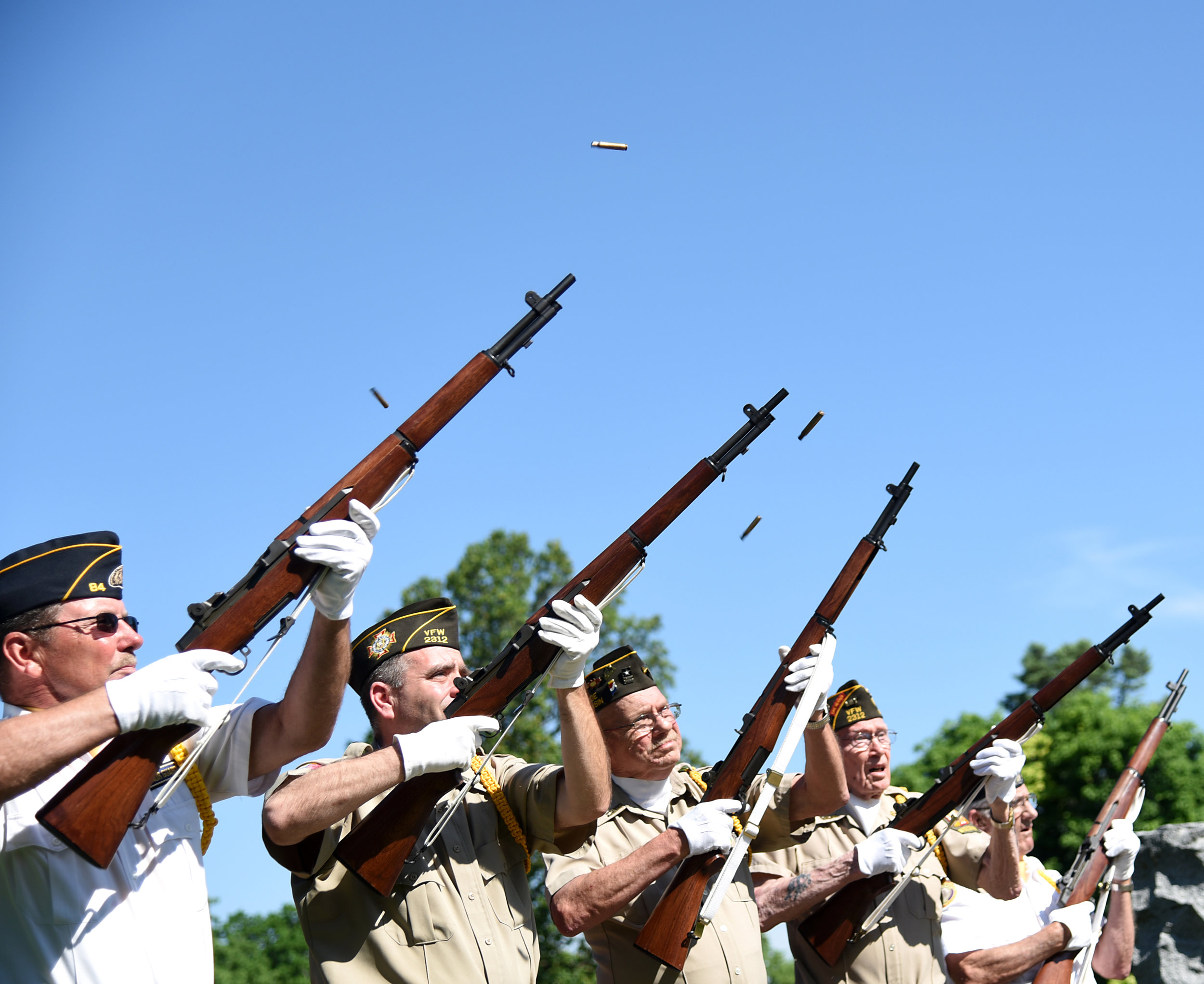 American Legion members Jim Moser, Lucian Lemak, Bill Haffele, Alvie Riese, and Al Buri shoot during the Memorial Day Ceremony at the Cemetery May 30, 2016.