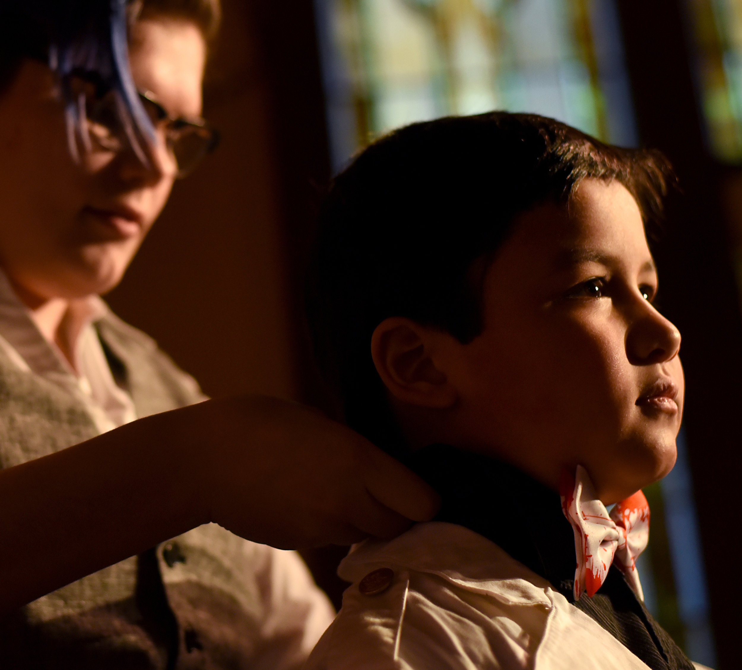 """Calli Vestin adjusts the bowtie on Jack Tran, 8, who plays the ghost of Hamlet's dad in a modern day adaptation of Hamlet, during a rehearsal at the Monroe Arts Center on Feb. 4, 2016.This is Tran's first play outside of school that he has been a part of. """"It's a lot of work,"""" Tran said, """"But it's a lot of fun."""""""