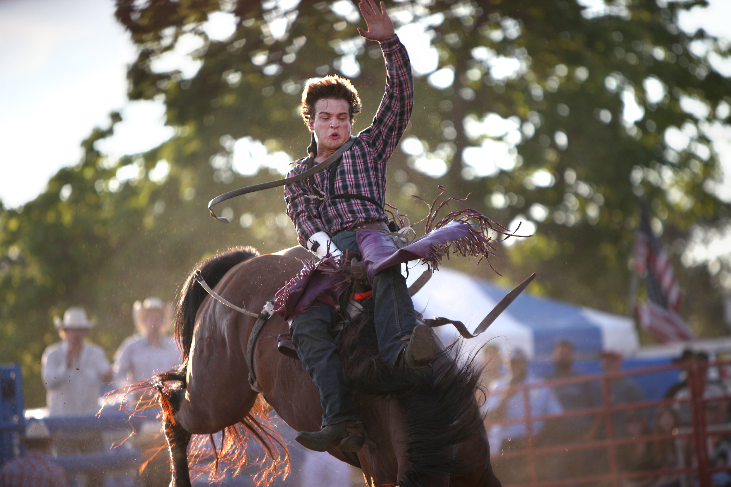 J.C. Hester, 22, from Marshall, Mo., competes in bare-back riding during Green County Fair's rodeo July 22, 2015.