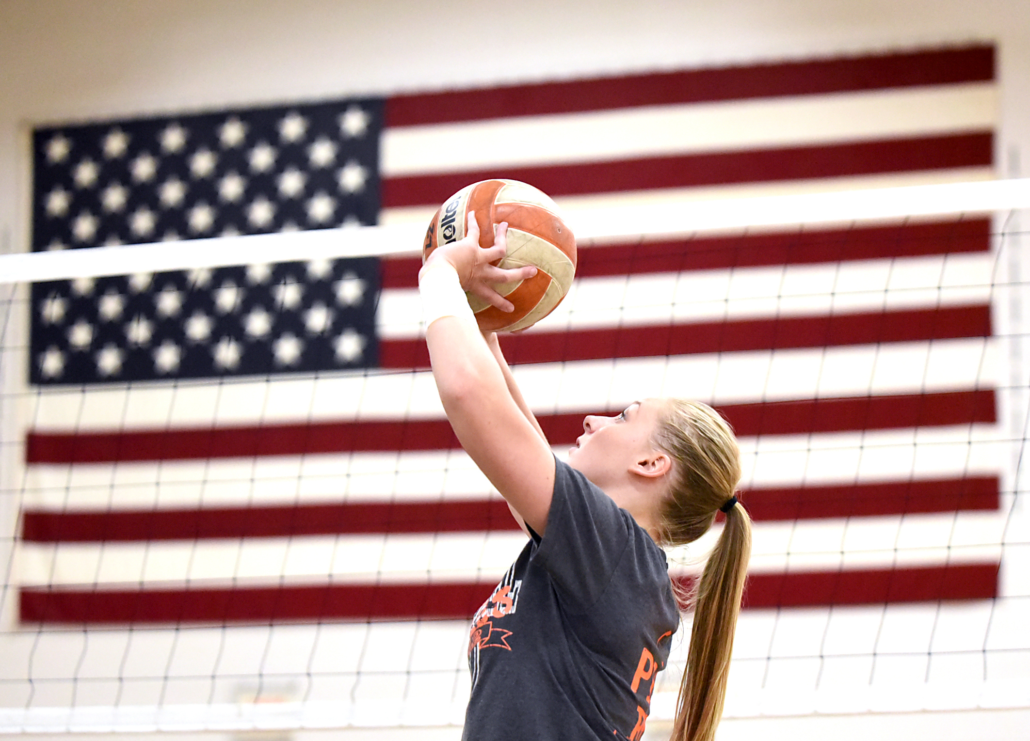 Kayla Butler-Paulson sets the ball during volleyball practice at Argyle High School Oct. 13, 2015.