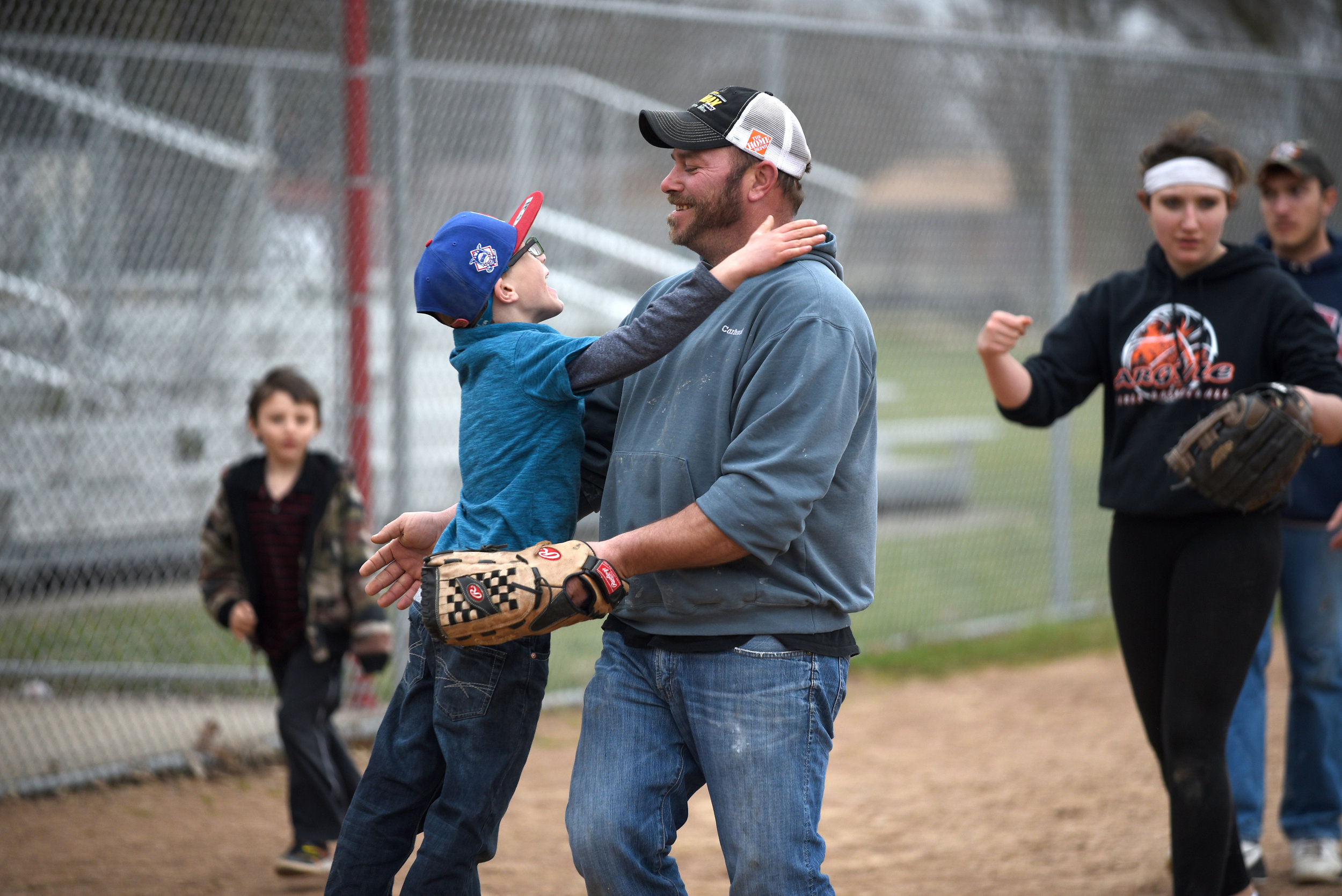 Mikey Helfvogt, 6, hugs his dad Keith Helfvogt, of Argyle, after a family game of softball after church at Twining Park April 2, 2017. The Helfvogt and Yaun families play almost every other Sunday after church. Their family is big enough for two teams.