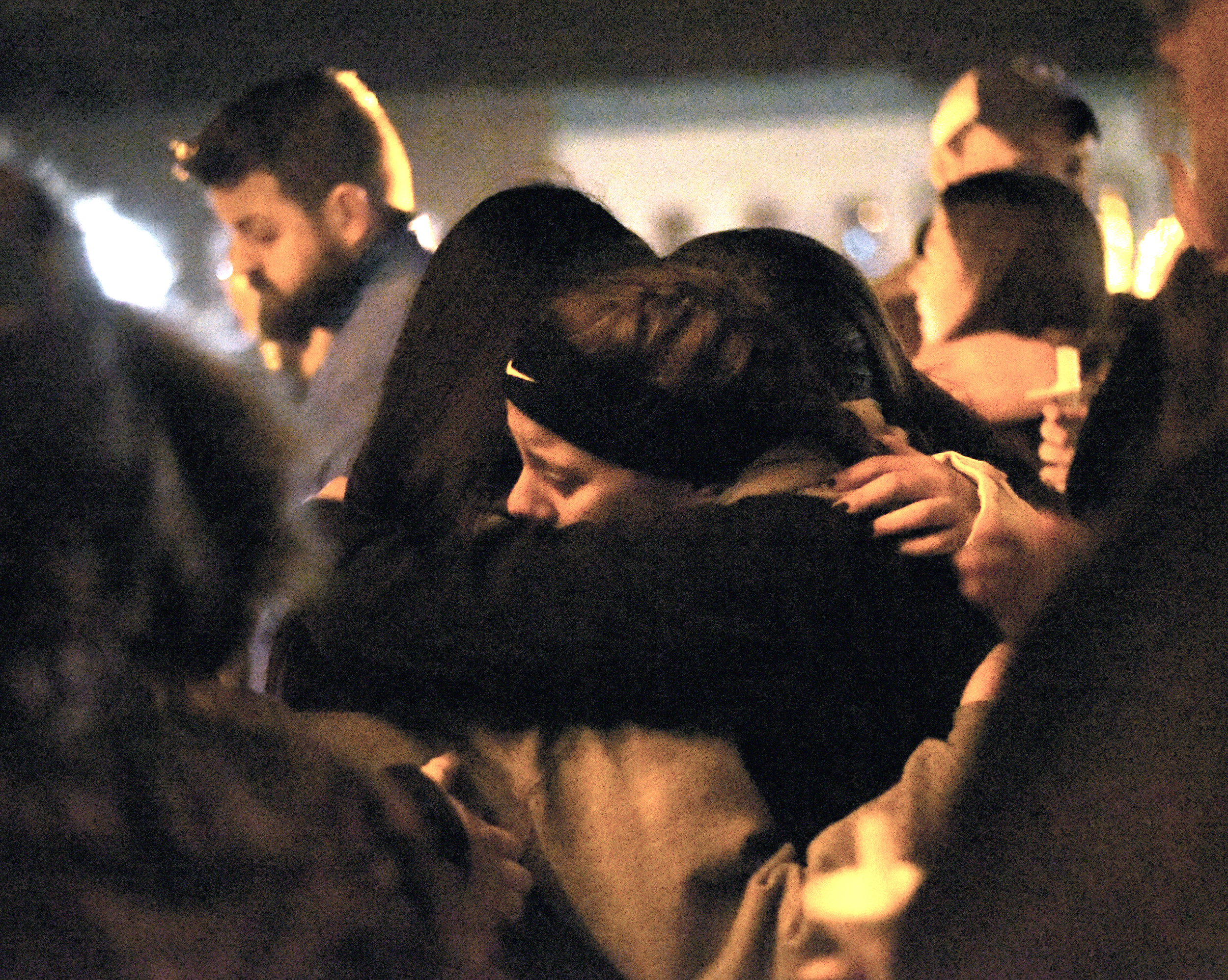 Monroe High School students console each other during a candlelight vigil for three students who died in a car crash, at the Courthouse Feb. 11, 2017.