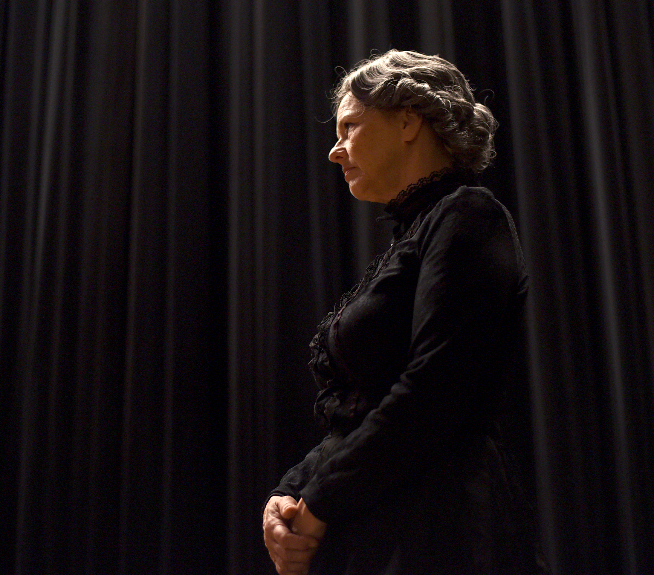 """Katie Doyle-Baumann dresses up as Susan B. Anthony during a dress rehearsal for the """"Within These Walls.."""" dinner show at Turner Hall on Nov. 11, 2015. """"She was a very stern person,"""" Doyle-Baumann said. """"It's very interesting playing her. I love the history of it."""""""