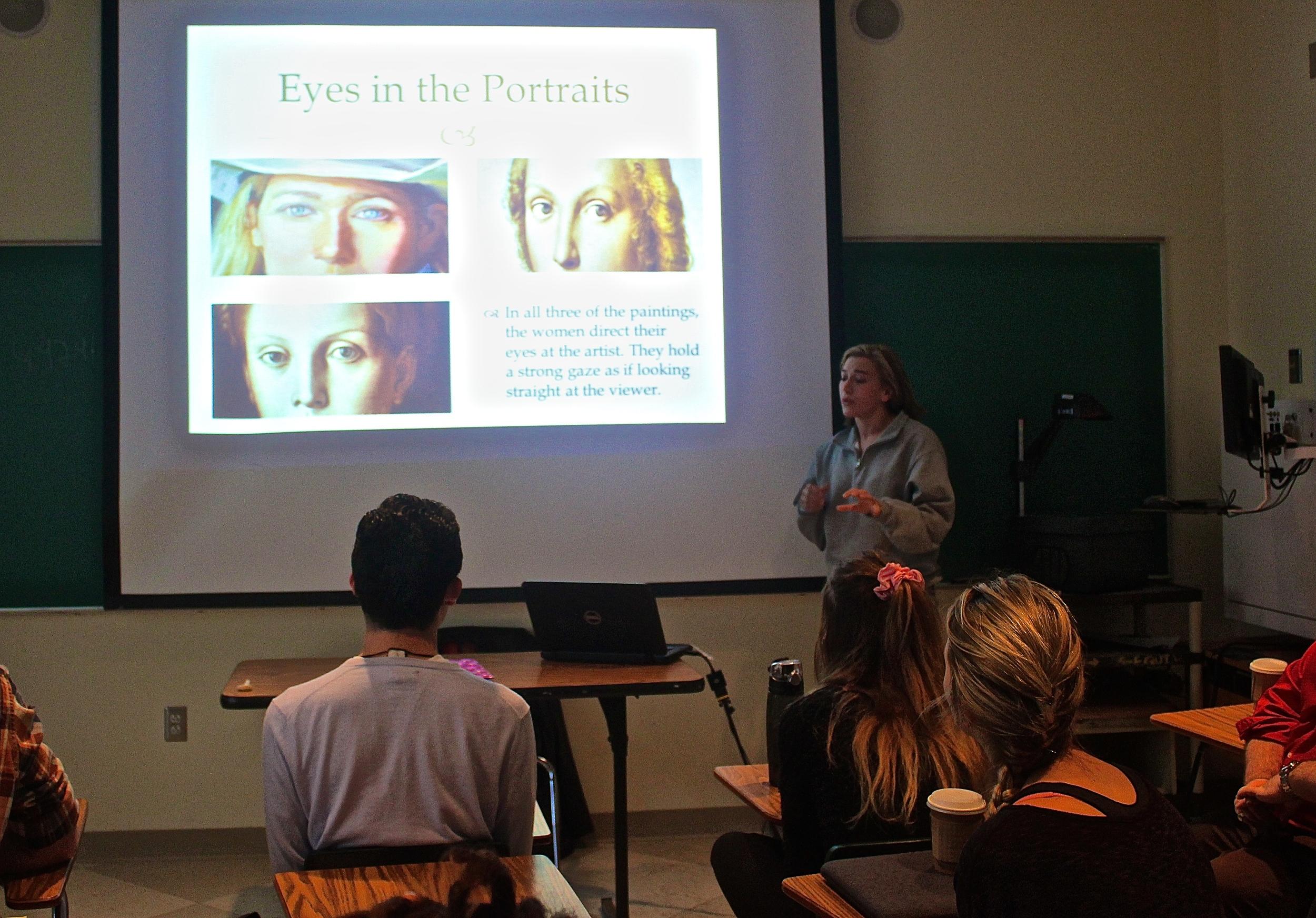 Madeleine Tucker reviews Elizabeth Poett's portrait, drawing comparisons to Raphael's Woman with Unicorn and Bronzino's Portrait of Lucrezia Panciatichi