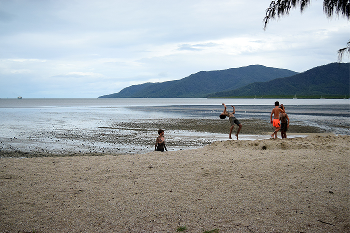 Kids doing backflips off the ledge of the mudflats. Don't worry, there weren't any crocodiles around!