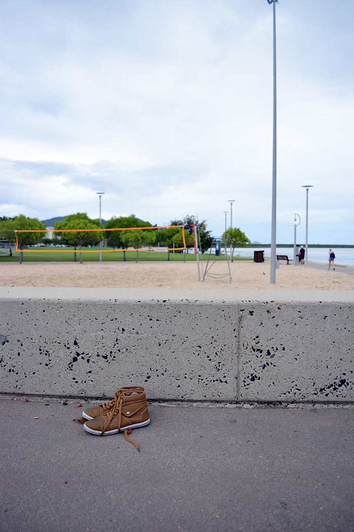 A kid left his sneakers behind while playing in one of the skate parks.