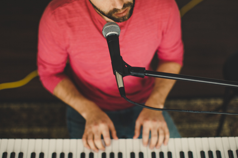 Daniel Alkato playing piano and singing