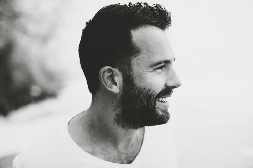 Daniel Alkato smiling black and white