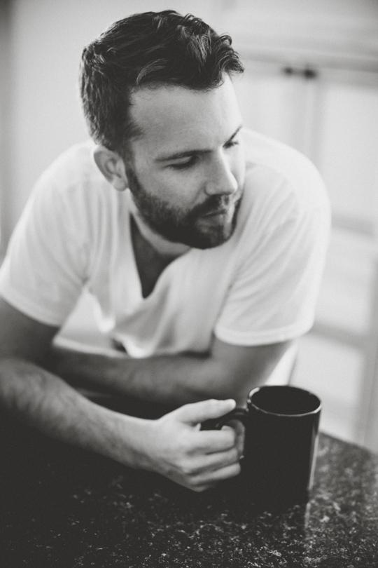 Daniel Alkato holding coffee mug