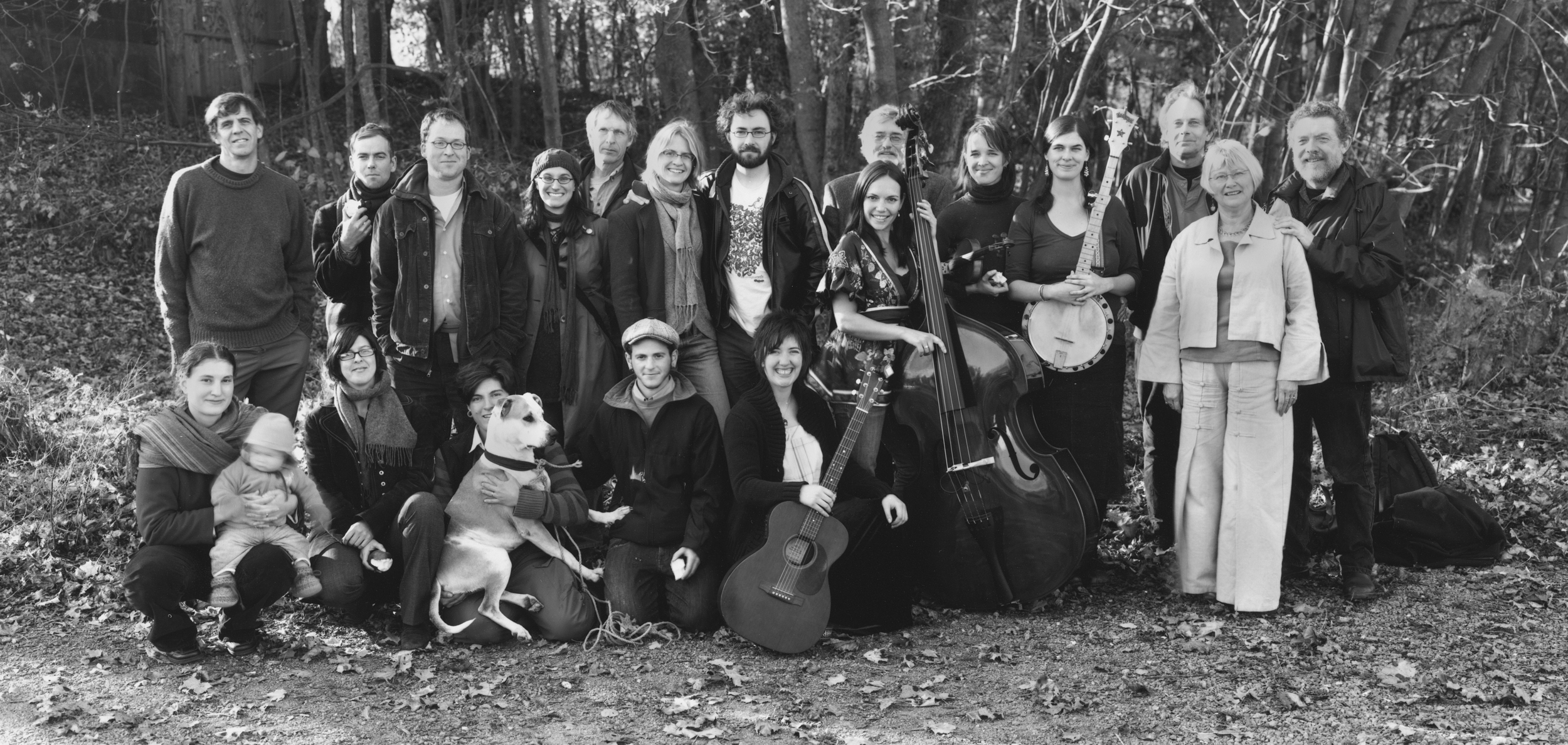 White Salt Mountain: A Gathering of Poets (Sackville, NB; 2008). Participating poets included Rob Winger (back row, third from the left), Anita Lahey (back row, fourth from the left), Amanda Jernigan (back row, sixth from the left), Peter Sanger (back row, just right of centre, behind the double bass), Allan Cooper (third from the right), and Harry Thurston (far right). The gathering was organized by Janna Graham (bottom row, third from the left, with the apple). Photograph by Thaddeus Holownia, http://www.anchoragepress.ca