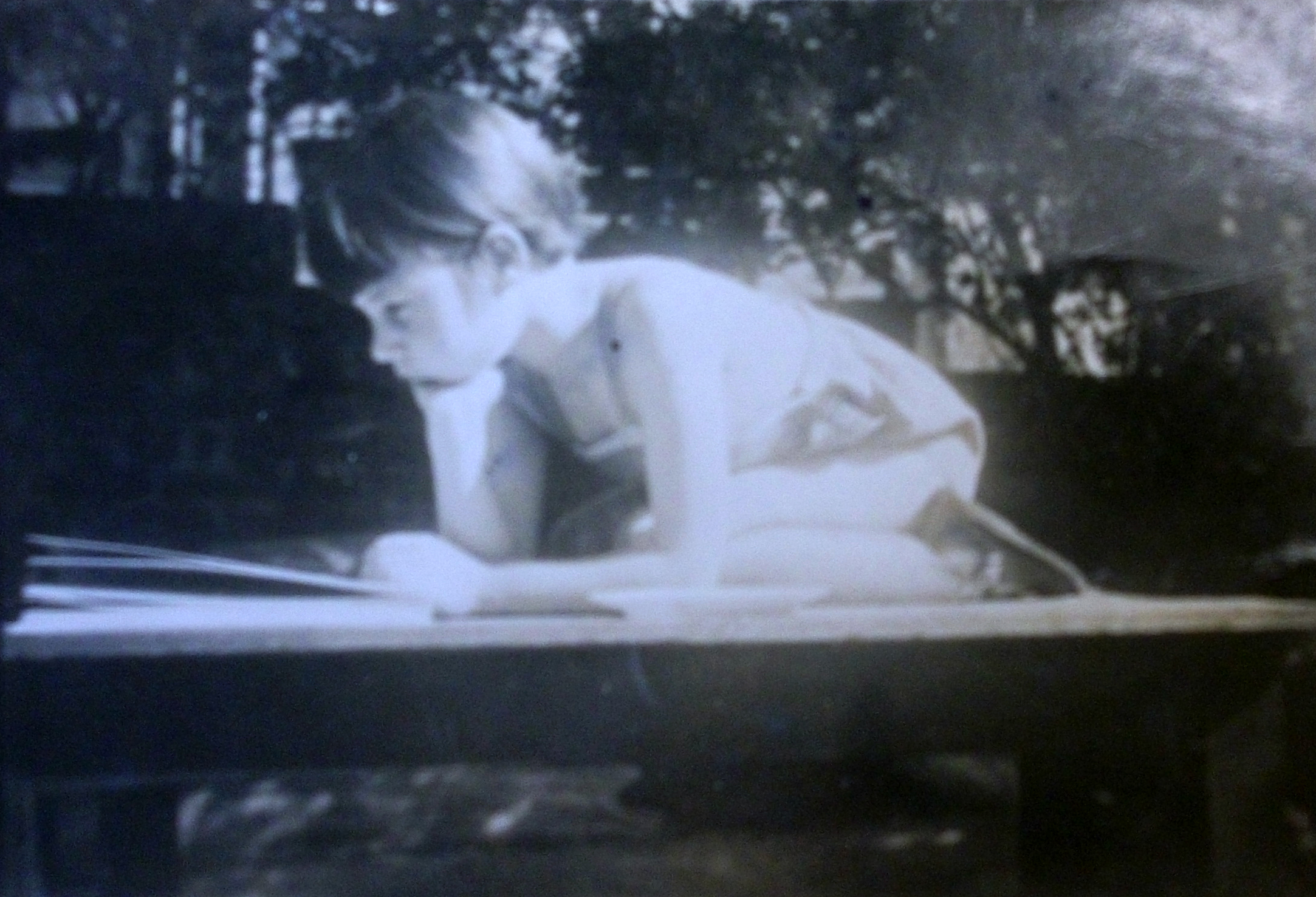Jay Macpherson reading as a child. Photo courtesy of the P.K. Page papers at Library and Archives Canada, with permission from Zailig Pollock and Diana Macpherson.