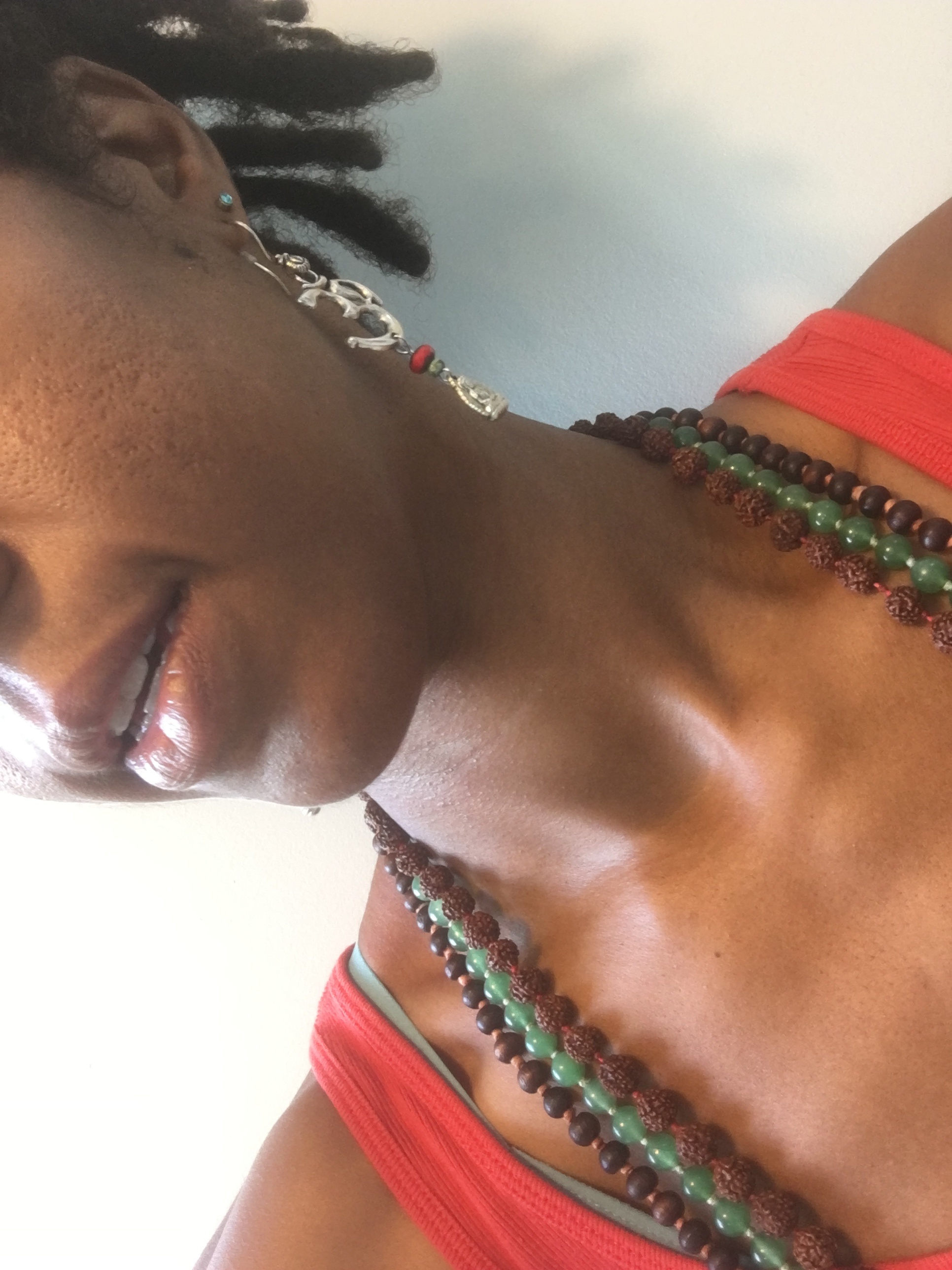 I never take good pictures of myself. Call it, clavicle with malas and earring.
