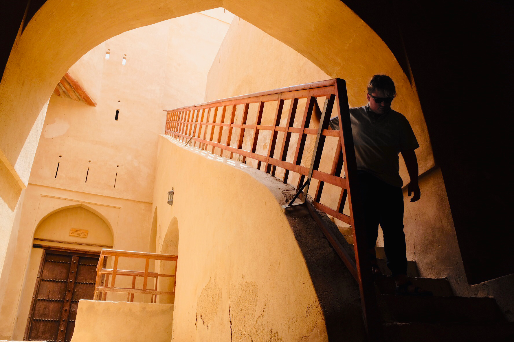 Coming down the stairs in Al Rustaq Fort