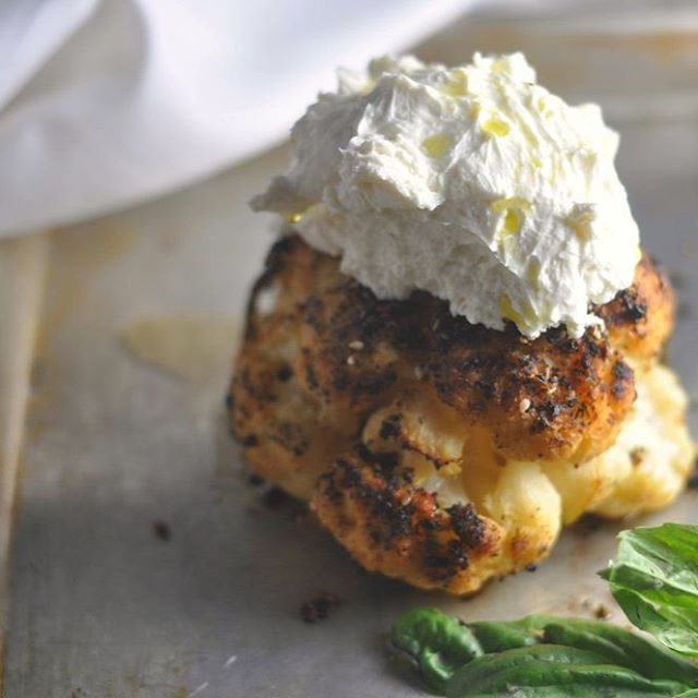 Whole roasted spiced cauliflower topped generously with whipped goat cheese.  A low carb take on one of my favorite restaurant dishes.  And now I can't stop singing Whip It. 😂 Recipe link in profile, music not included.  #grainfree #lowcarb #atkins #modlowcarb #modernlowcarb #keto #banting #eeeeeats #feedfeed #glutenfree #huffposttaste #instafood #jerf #lactopaleo #primal #recipe #cauliflower #roastcauliflower