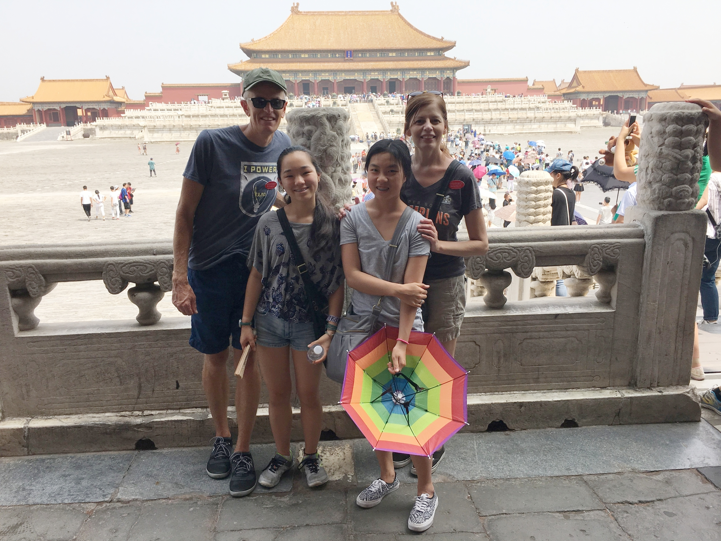 Beijing -Touring the Forbidden City with my family alongside thousands of other visitors. Behind us stands the Hall of Supreme Harmony (Taihedian) -- the throne hall of Ming and Qing emperors.