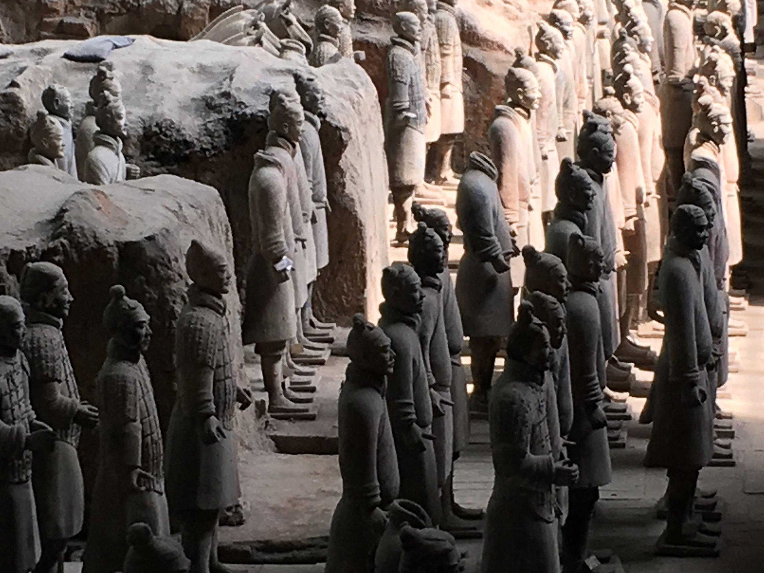 Xi'an - Early morning light shining on some of the nearly 8000 life-size terra cotta soldiers commissioned by Qin Shi Huang, China's First Emperor and founder of the Qin Dynasty,to protect him in the afterlife. The soldiers were discovered in 1974 (I was six years old).