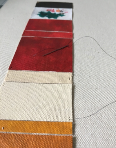 I sewed soft, painted canvas swatches to the background canvas using 34 gauge annealed wire. The swatches represent the colors depicted in Ishiuchi's photograph.